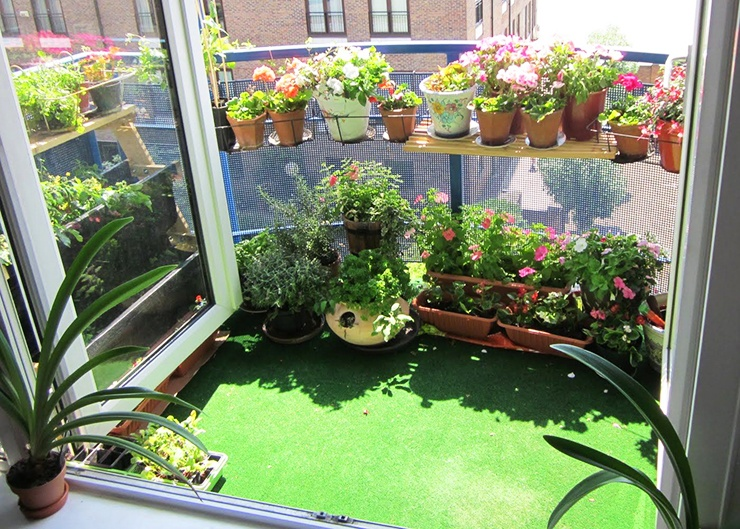 apartment garden on balcony with stands and pots
