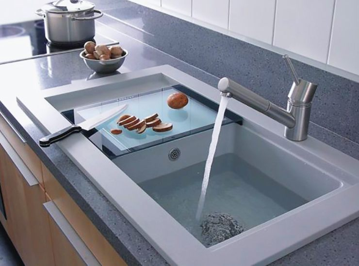 big modern kitchen sink with sliding cutting board