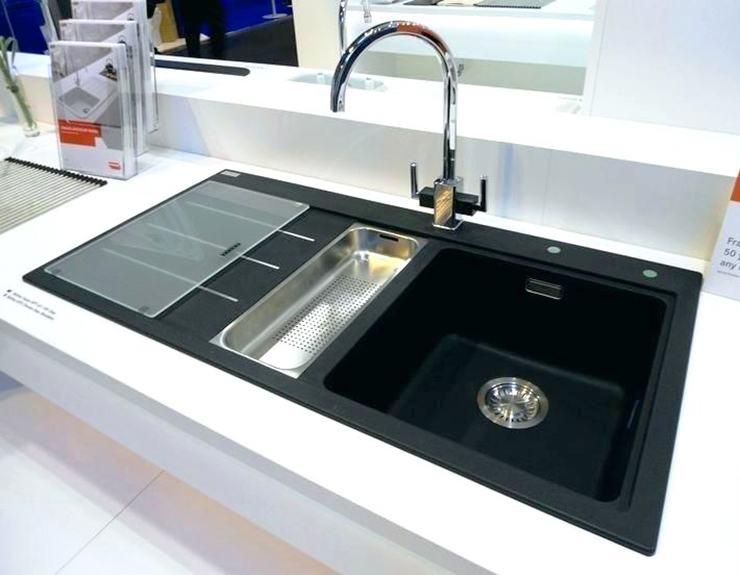 modern kitchen sink with drainage trap and vegetable rinse