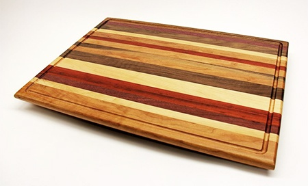 cutting board with juice grooves around the sides
