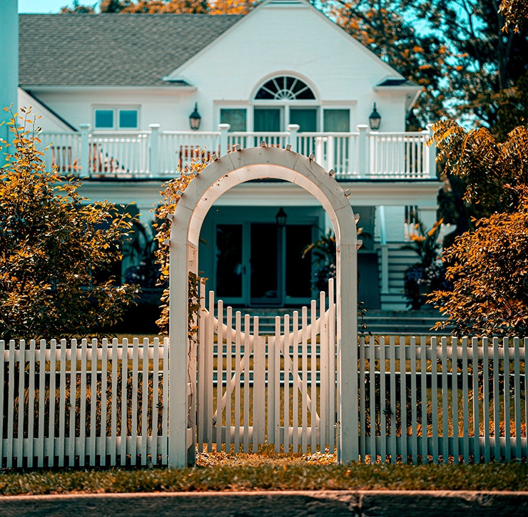white spaced picket fence with arch top gate