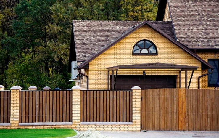 wooden flat top brick fence