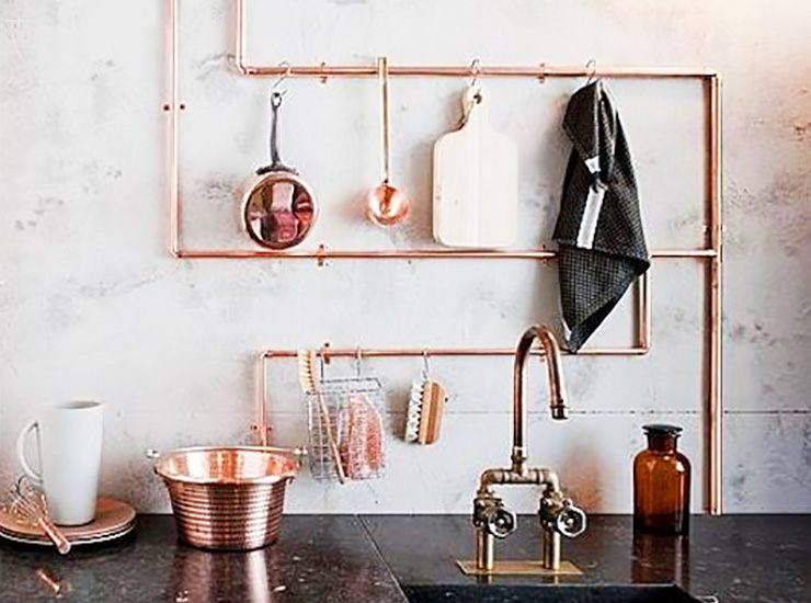hanging items on kitchen pipes to hide them and make them functional
