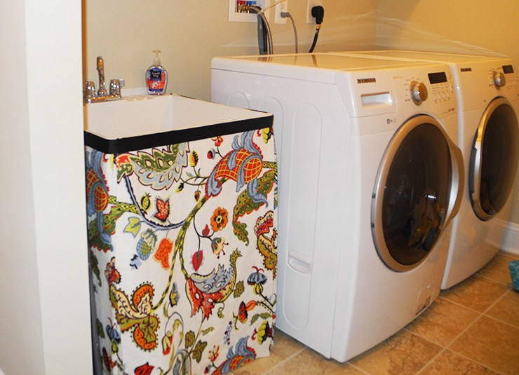 sink skirt to hide exposed pipes in laundry room