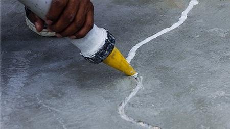 fixing cracks in garage floor