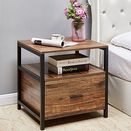 bedside tables are used in the bedroom beside the bed so the sleeper can rest books, drinks, and TV remotes, for instance.