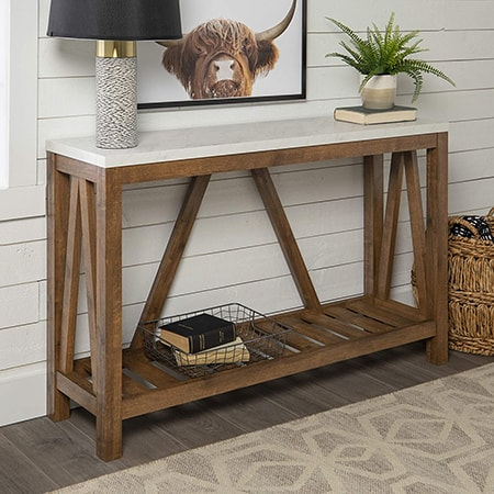 console tables can hold televisions, decorations behind a couch, or be placed along the wall in a hallway or entryway.