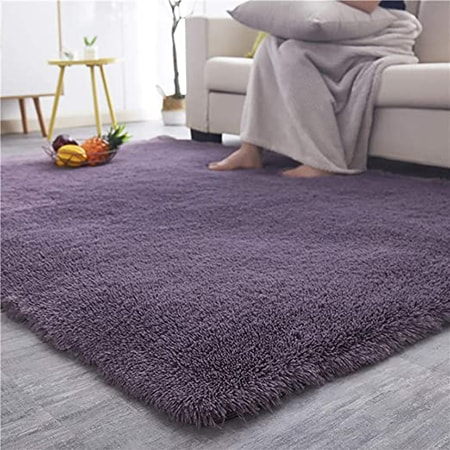polyester rugs are tough and durable, hold their dye color very well, and have a higher price due to the effort to manufacture.