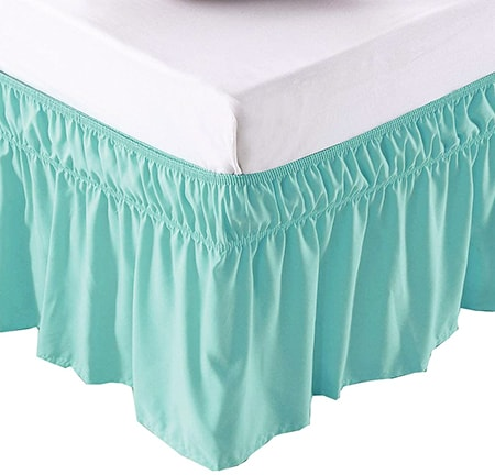 using a window valence is a clever alternative to a bed skirt that fits and looks as authentic
