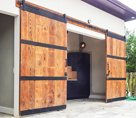 barn doors as garage door alternatives are a great and attractive solution to the traditional option