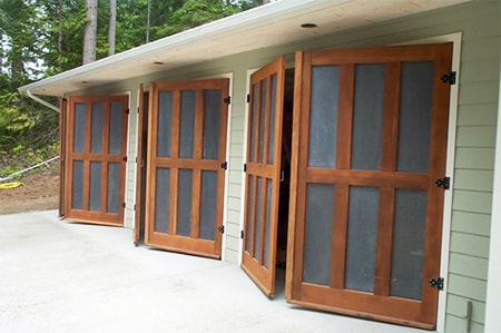 carriage garage doors open up from the center and swing outwards to either side