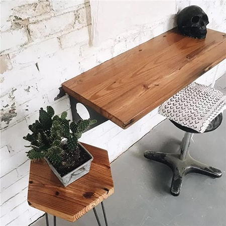 floating wall desks save tons of space underneath and frankly just look cool