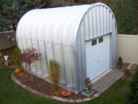 quonset huts are the perfect alternatives to garages, used by the military to store vehicles every day