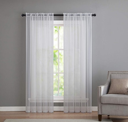 sheer curtains are one of the types of curtains used as either a liner for more opaque ones or as a decorative but less functional element