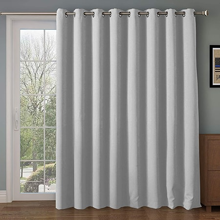 single panel curtains cover an entire window or sliding glass door with one long curtain