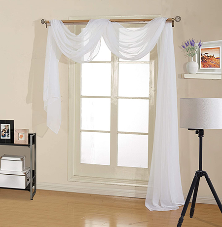a window scarf is exactly that, a long curtain that wraps over the rod and dangles down for decoration but not functionality