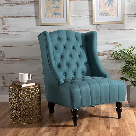 wingback chair are fancy types of chairs that don't have arms and the wings don't stick out much. it's mainly for decorative reasons