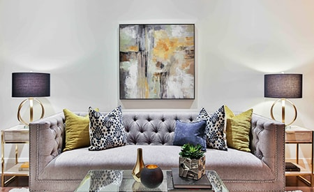 Having big artwork prints, paintings, or photographs is a great way to project a cozy and calming atmosphere into your living room