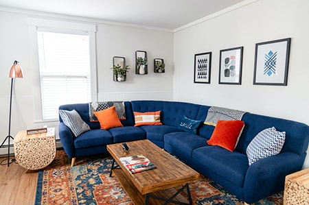one of the best ways to make a living room cozy is to have a giant sectional sofa that your guests can sprawl out on