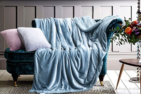 colorful throw blankets in the living room help guests feel comfy, playful, and cozy, especially in the colder months