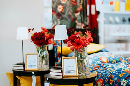 flowers add brightness to a living room to add some extra flair and color which brings some energy to the decor and makes it feel cozy like a garden