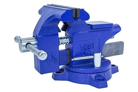 a bench vise is secured to your work bench and then can hold objects in various positions so you can work on them