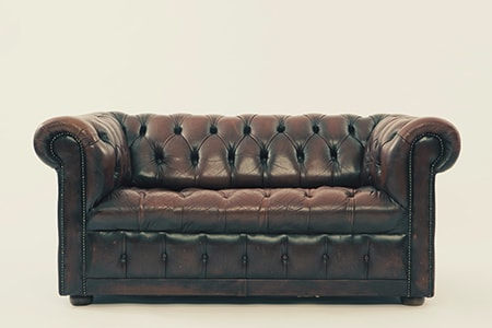 the chesterfield couch is one of those styles of couches that seem masculine and makes one think of a CEO's office