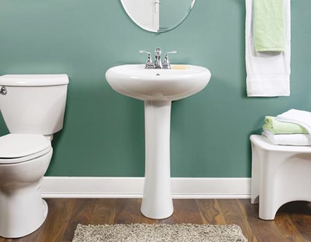 In smaller bathrooms you'll see the pedestal sink types of basins that take up very little room due to the lack of cabinetry under it
