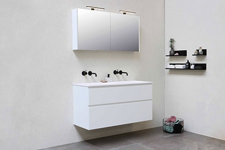 A vanity sink is always found in a bathroom and will contain cabinetry below and usually mirrors that have storage space behind them too
