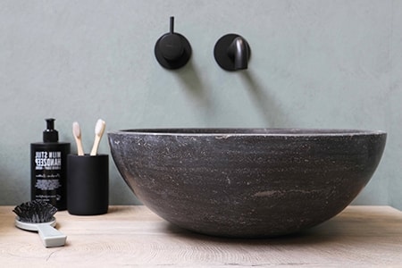 A vessel sink is one of the more unique bathroom sink styles that are situated on top of the countertop instead of within it