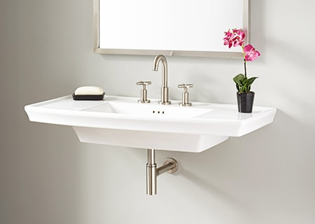 A wall mount sink takes up even less space than the pedestal types of sinks for bathrooms but you shouldn't place too much weight on them