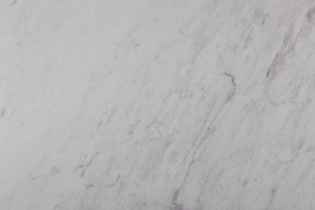 white himalaya varieties of marble  are subdued but very grey in color