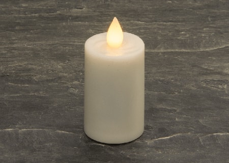 an electric candle is a much safer candle replacement because there's no actual fire